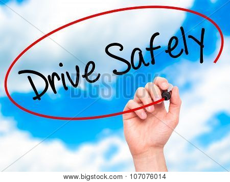 Man Hand writing Drive Safely with black marker on visual screen