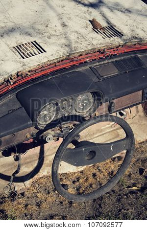 Filtered Vintage Photo Of Steering Wheel And Rusty Speedometer On Dashboard