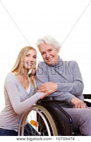 Happy Woman Sitting In Wheelchair