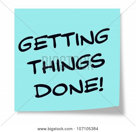 Getting Things Done written on a blue sticky note making a great concept. poster