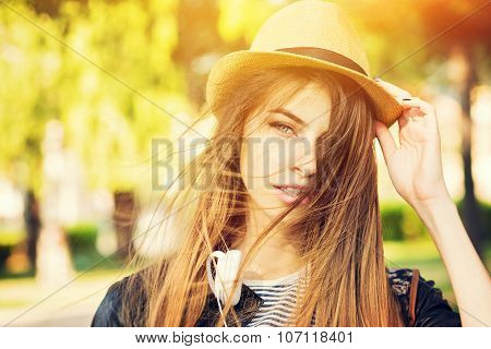 Beautiful teenage girl with hat in park