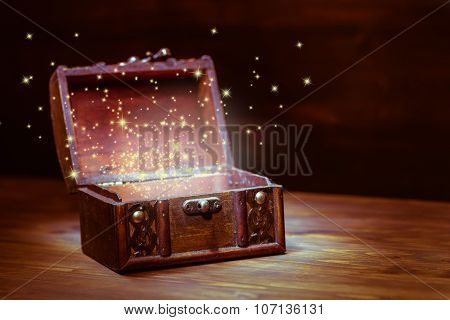 Beautiful Background Of Mystery Chest With Light Miracle On Wooden Background With Place For Text, C