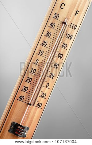 Close-up Wooden Thermometer Scale Isolated On White Background