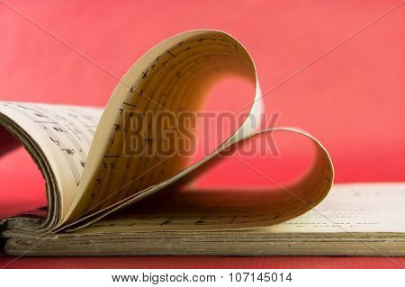 Music Notation Book With Pages Shaping Heart Closeup