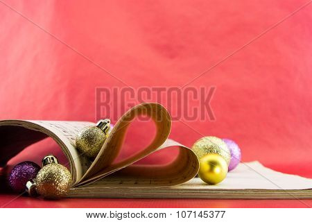 Music Notation Book With Pages Shaping Heart And Christmas Ornaments