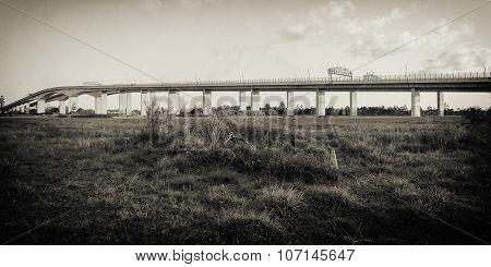 The Gateway Bridge (Sir Leo Hielscher Bridges) at sunset in Brisbane, Queensland, Australia. Abstract black and white image. poster