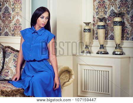 Woman In Blue Dress In Luxury Interior.