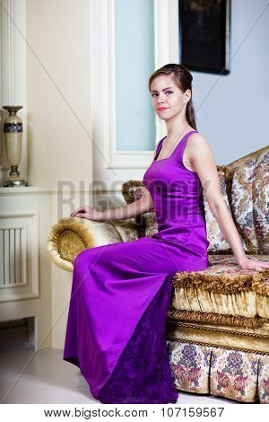 Woman In Purple Dress In Luxury Interior.