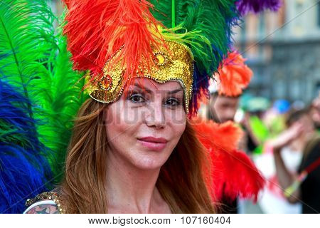 Naples, Italy, July 11 2015: A Partecipant With Colored Plumage In The Naples Gay Pride Parade. Thou