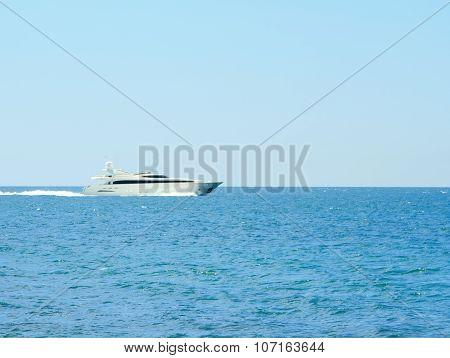 Luxury white speed yatch in open waters full ahead