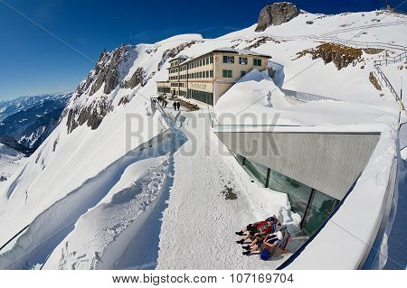 People sunbathe at the terrace of the Pilatus-Kulm luxury hotel at the top of the Pilatus mountain i