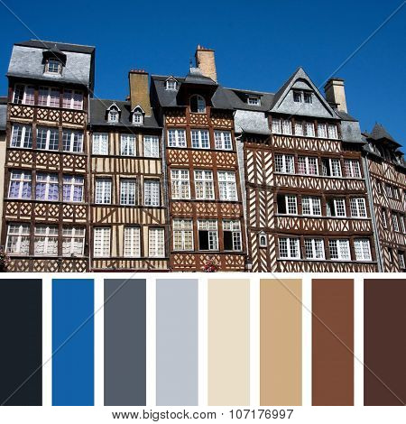 The half-timbered buildings of historic Rennes, Brittany, Northern France, against clear blue sky. In a colour palette with complimentary colour swatches.