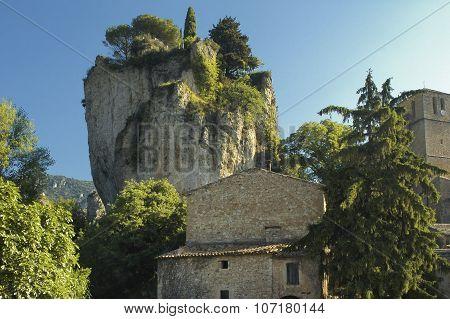 Moureze (Herault Languedoc-Roussillon France): strange rocks and old village poster