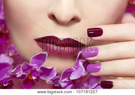 Pink maroon manicure .