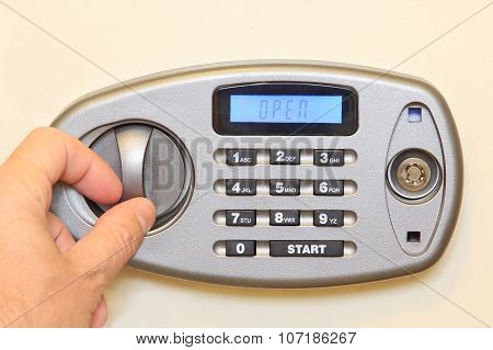Man Hand Open Of Electronic Home Safe.