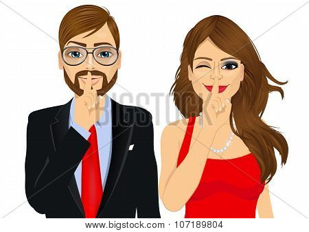 portrait of handsome businessman and attractive woman winking, making silence or secret hand gesture with finger on their lips poster