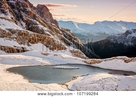 Snow and mountain lake Lago dei Piani near Drei Zinnen or The cime Italy Alps Dolomites