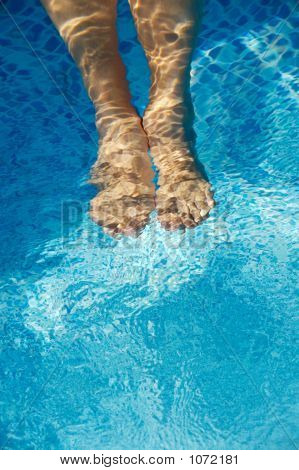Feet Refreshing In Swimming Pool
