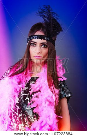 Girl Pink Plume And Black Feather On Head. Carnival.