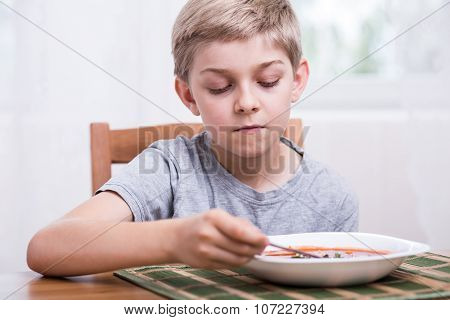 Boy Eating Soup
