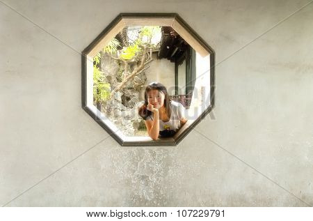 Chinese Woman In Octagon Window