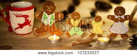 Christmas gingerbread men candles with cinnamon stars Pine twig Christmas ball