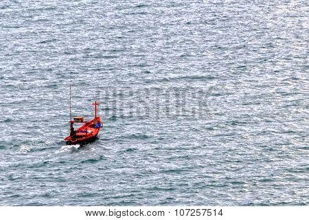 Fisherman Boat Sailing In The Sea