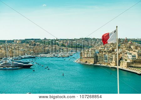panoramic view on Valletta  with the flag of Malta in the foreground