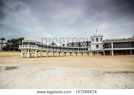 Old bathhouse on beach in Cadiz, Spain