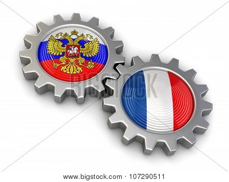Russian and French flags on a gears (clipping path included)