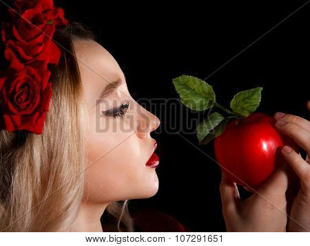 Young Lady Holding A Red Apple