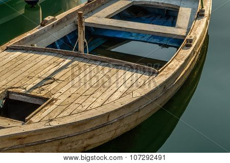 Wooden retro boat on a water