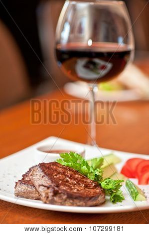 grilled beef steak with sauce and wine