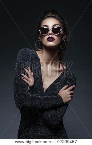 Beautiful girl in dress and sunglasses