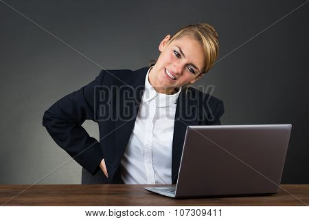 Businesswoman Suffering From Backpain While Using Laptop