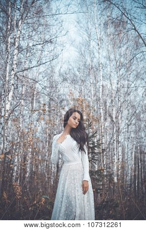 Beautiful Lady In A Birch Forest