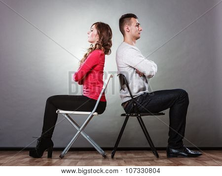 Young Couple After Quarrel Sitting Back To Back