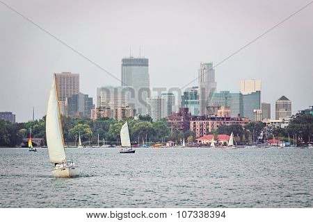 Scenic View of Downtown Minneapolis, Minnesota With Lake Calhoun and Sail Boats in Foreground