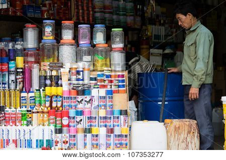 Vietnamese small business owner selling different kinds of chemical products