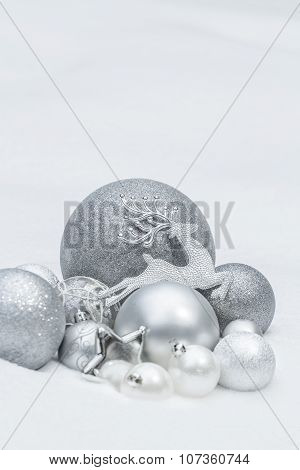 Holiday Silver Decorative Christmas Baubles And Star With Santa Claus's Reindeer At Natural Snow