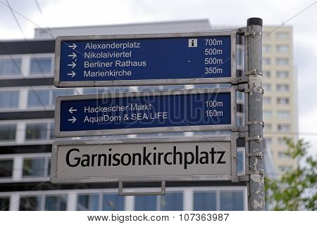 Street Sign In Berlin With Some Wellknown Landmarks On It