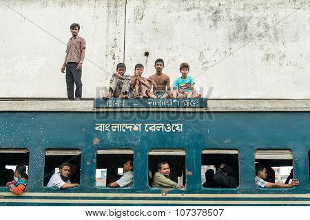 Commuters In Train Looking Through Window