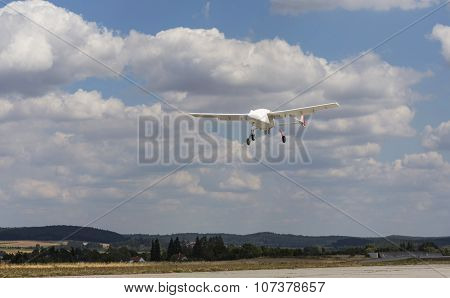 Unmanned aerial vehicle (UAV) in the sky. poster