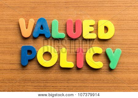 valued policy colorful word on the wooden background poster