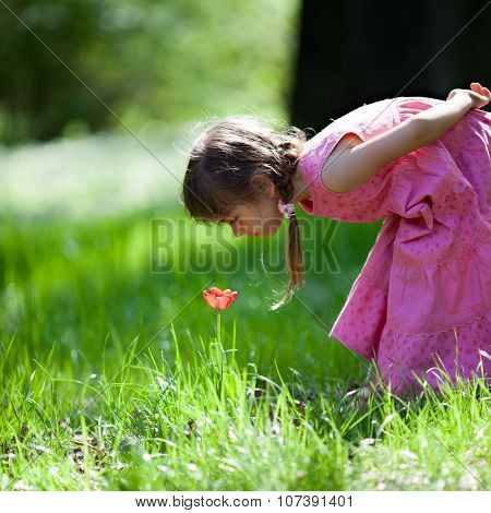 Little Girl Sniffing Flower