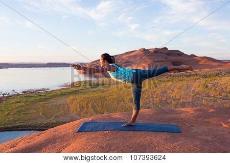 Girl Doing Yoga By The Lake