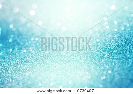 blue abstract light background, sparkling glittering background with turquoise light