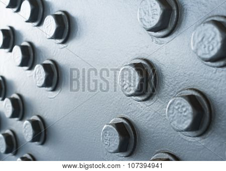 Gray Painted Metal Surface With Hexagonal Bolt Heads