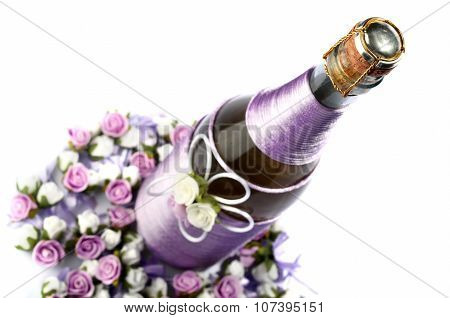 Decorated Wedding Bottle Of Champagne With Roses, Isolated