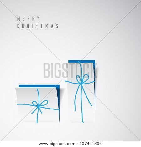 Vector Merry Christmas card with a white minimalistic gift boxes cut out of paper poster